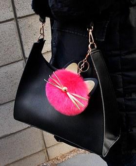 1049256 - 金点绒球猫包包的魅力钥匙圈